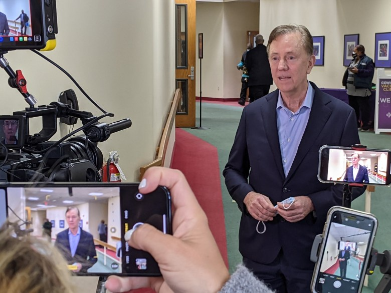 Gov. Ned Lamont gives a media interview  (Hugh McQuaid / CTNewsJunkie)