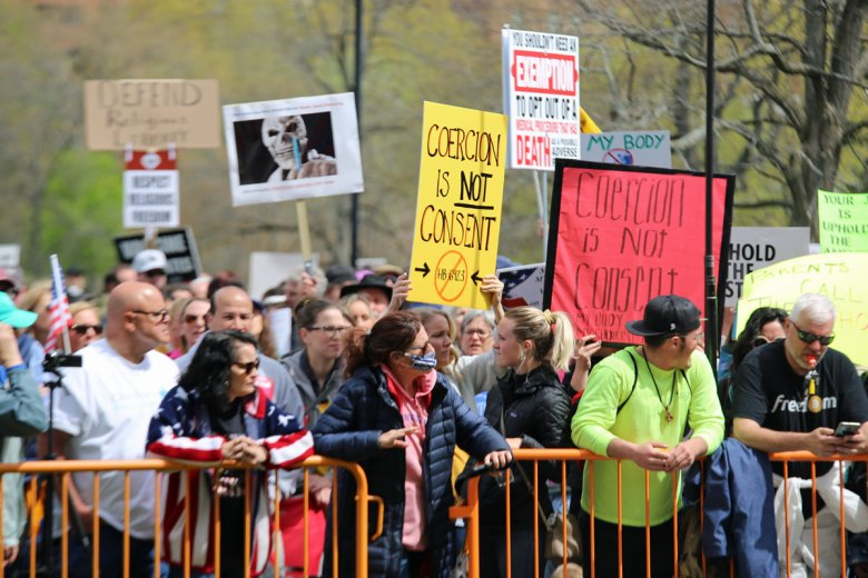 A crowd at the state Capitol on April 27, 2021, rallies against a proposal to eliminate the religious exemption to school vaccinations.