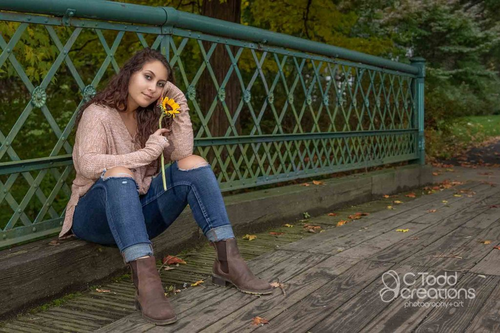 senior portrait on a bridge