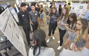 Students discuss the findings of a Valencia High School team nanotechnology project during the 7th annual Nanoscience Research Project Poster Session. Photo credit: Dan Watson/The Signal