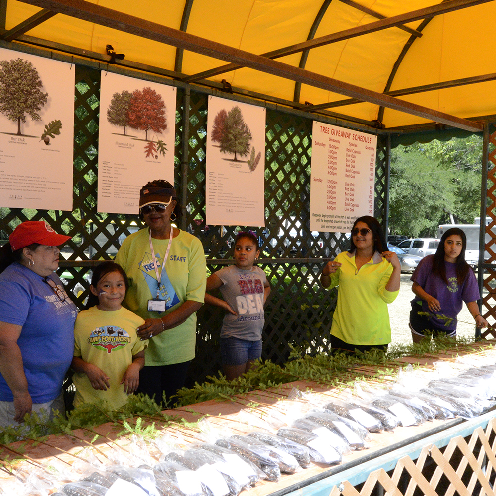 City of Fort Worth Employees and family volunteering at the May Fest Tree Give-a-way booth - 1000