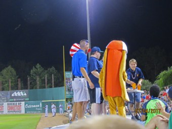Hot dog eating contest with moths in upper left corner!