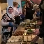 woman serving food in church