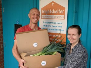 two people with box of vegtables