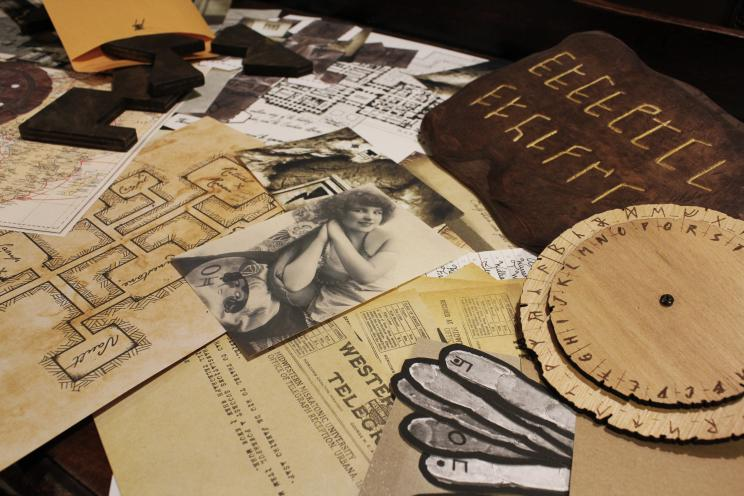 Assemblage of papers and props