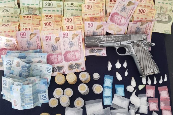 dinero droga y arma decomisada