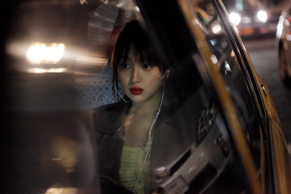 like-someone-in-love-2012-003-young-woman-in-taxi-night.jpg