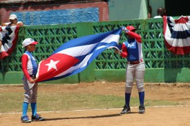 Presenting the Cuban flag during the opening ceremonies.