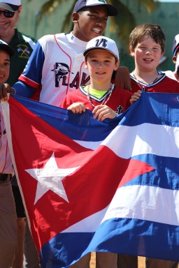 Holding the U.S. and Cuban flags, along with the Vermont state flag, side-by-side following the game against Playa.
