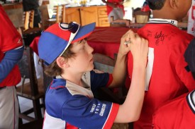 Signing a Cuban player's uniform after dinner.