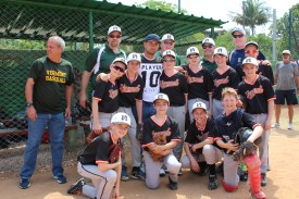 Frank Camilo Moregon, the starting catcher for the Havana Industriales and the Cuban National Team, poses with the Vermont team.