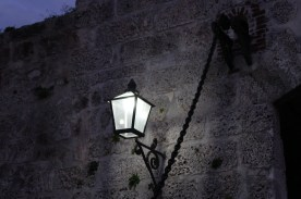 A streetlamp lighting the way inside the historic fort for a cannon firing ceremony.