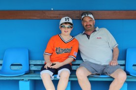 Vermonters Ozzie and Dave Kost pose for a photo inside the Havana Industriales dugout at the Estadio Latinoamericano.