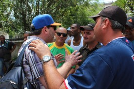 Vermont Coach Tom Simon chats with locals about baseball at the Hot Corner in Havana's Central Park.