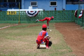 A pitcher for the Cuban team Marianao warms up in the bullpen prior to the game against Vermont.