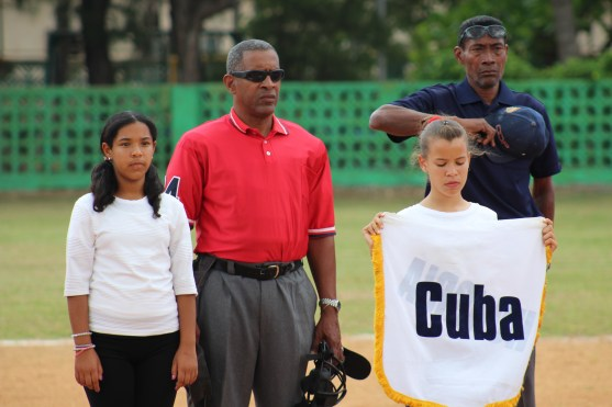 Cuban umpires stand to respect the playing of the U.S. National Anthem.