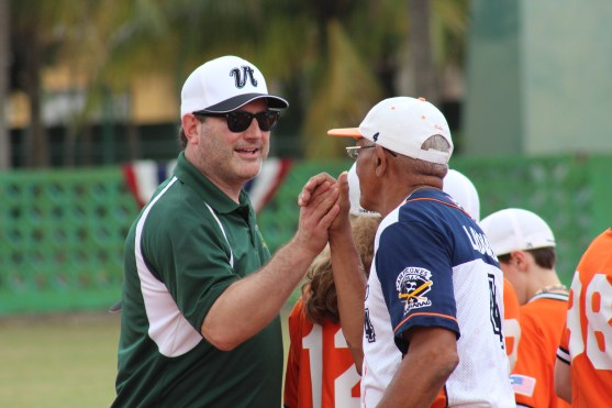 Vermont coach Tom Simon shakes hands with Marianao coach Leonis Acosta before the game.
