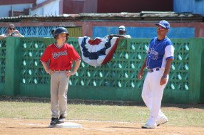 Ollie Pudvar waits for instruction from his new coach after reaching first base.