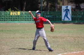 Andrew Goodrich makes a throw while playing shortstop against the Havana provincial team.