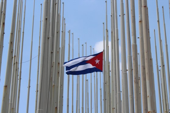 A group of countless flag poles, a reminder of the Cold War. Many Cuban flags once flew here to block propaganda projected by the U.S.