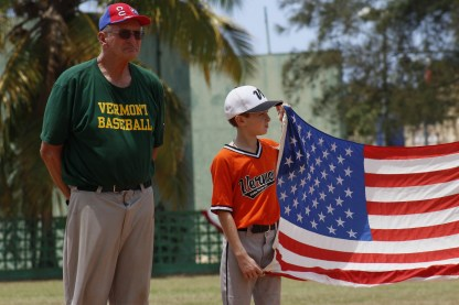 Vermont Coach Jim Carter alongside player August Rinehart during the playing of the National Anthem.