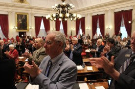 The Vermont House of Representatives rise for a standing ovation.