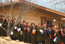 bhutan-thimpu-bhutanese-high-school-students-watching-the-bhutan-vs-us-basketball-game-lindsey-weaver-2006