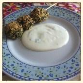 Polpettine di spinaci su salsa al gorgonzola