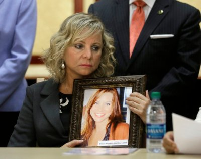 "FILE - In a Tuesday, Aug. 18, 2015 file photo, Debbie Ziegler holds a photo of her daughter, Brittany Maynard, during a news conference to announce the reintroduction of right to die legislation, in Sacramento,Calif. The Simon & Schuster imprint Emily Bestler Books told The Associated Press on Tuesday, Sept. 8, 2015, that Deborah Ziegler's memoir, ""Wild and Precious Life,"" was scheduled for late in 2016. (AP Photo/Rich Pedroncelli)"