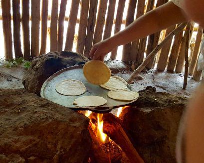 Maya woman cooking hand pressed corn tortillas, Aldea Ahau Chooc, Quintana Roo.