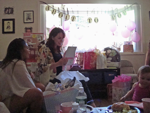 about to pop baby shower opening gifts