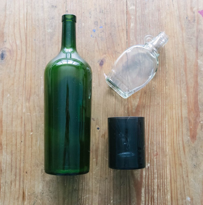 remove sticky residue to transform old bottles into recycled bottle vases