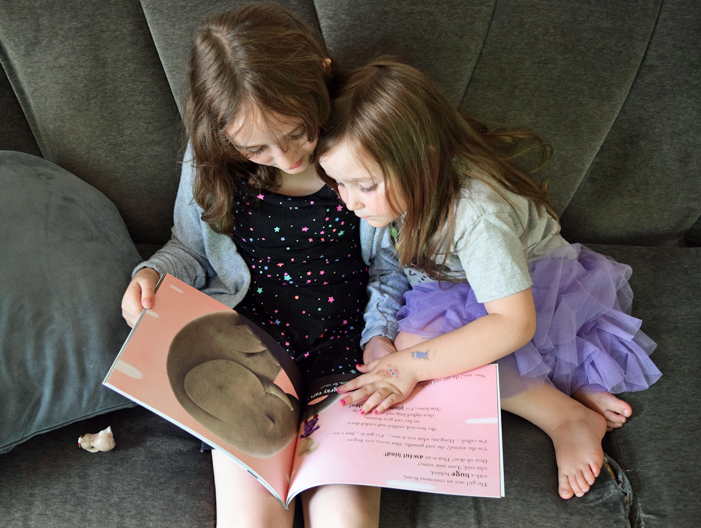 sisters reading The Little Girl Who Lost Her Name