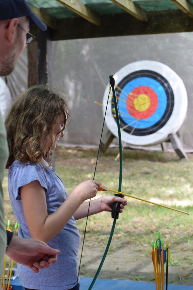 trying out archery at the NY Renaissance Faire