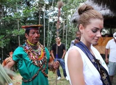 A tourist undergoing a shamanic cleansing ritual.