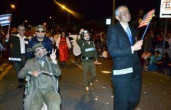 A wheelchair-bound Fidel Castro was part of the spoofing at Tuesday night's parade of the innocents.
