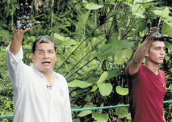 """President Rafael Correa is """"oily hand"""" media event in early 2014."""