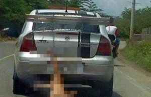 Social media picture of dog being dragged behind car.