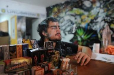 Owner of marijuana shop in Montevideo, Juan Manuel, at work. Photo credit: Getty