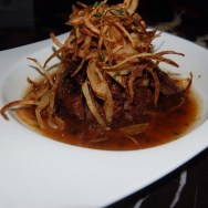 Beef Tenderloin Special set in Yuzu Truffle Butter and finished with Crispy Onion Straws at NOBU