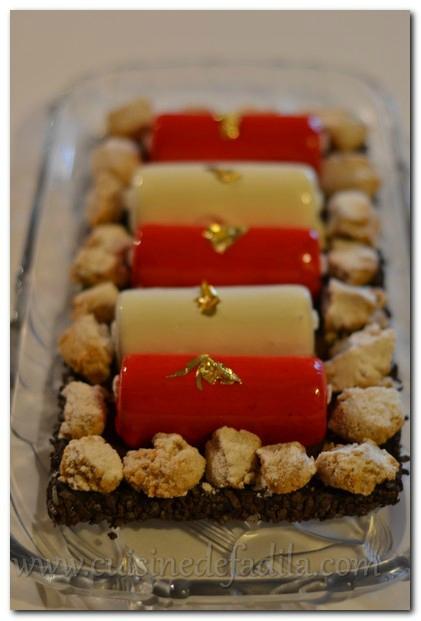 Bûche rouge et blanc : chocolat au lait coeur crémeux à la clémentine et biscuit à l'orange confite
