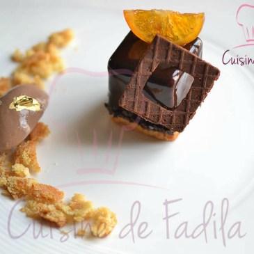 L'oramalga : entremets chocolat et son crémeux orange, sablé breton et glace pure origine Madagascar