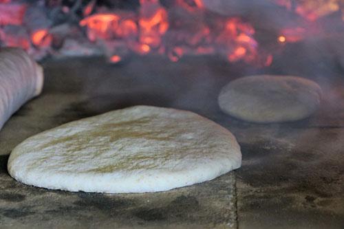 Cuisson Pitas four à bois