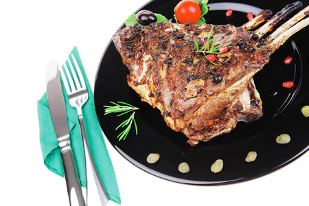 37812164 - ribs rack served over black plate isolated on white