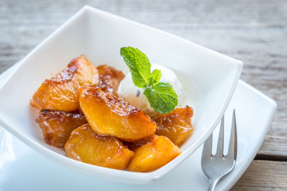 44220472 - caramelized peaches