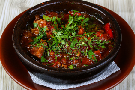 48793608 - baked tomato and eggplant served fresh green herbs