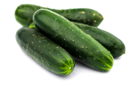 52595246 - fresh cucumbers isolated on white