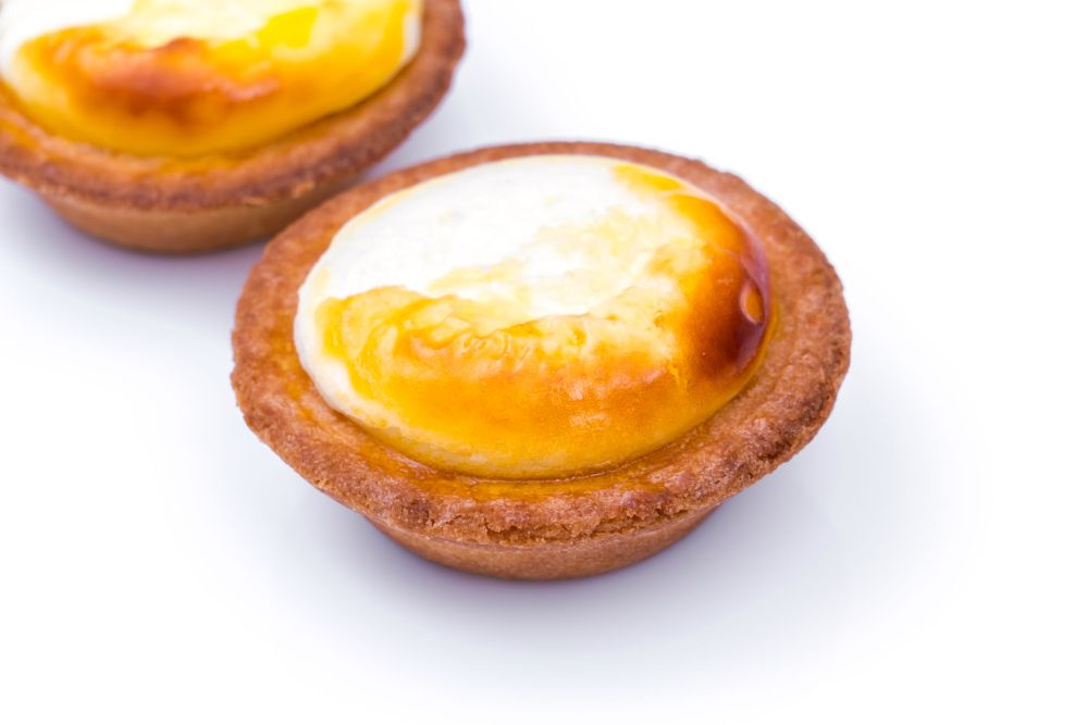 62580649 - cheese tart on white background