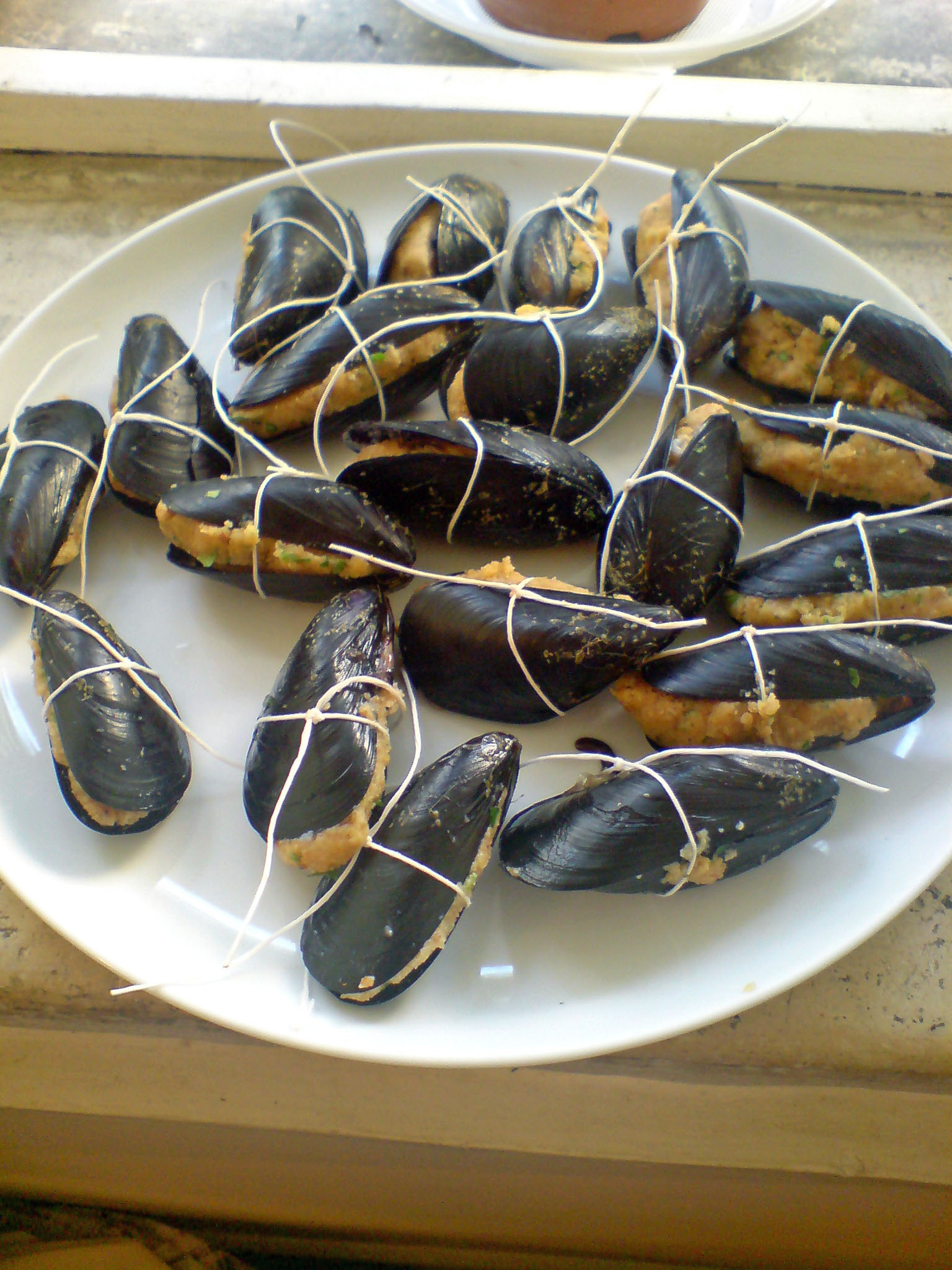 Stuffed mussels ready to cook