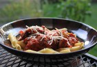 Grilled Italian sausage with marinara sauce over penne pasta